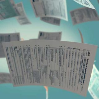 Image of copies of IRS Form SS-4 in freefall, representing how Simantob Law Group helps with forming a limited liability company and opening the required LLC bank account.