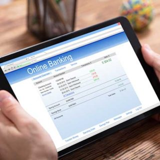 Image of a tablet open to a bank account's statement, representing how clients in the US and abroad rely on Simantob Law Group to help with limited liability company formation, opening an LLC bank account, and ongoing LLC, business, and real estate matters.